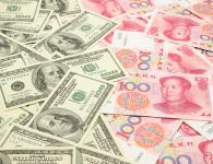Chinese Yuan Aims to Knock Out the American Dollar